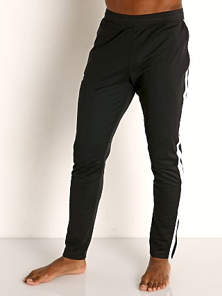 Model in black/white Under Armour Sportstyle Pique Track Pant
