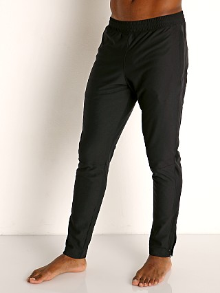 Model in black/black Under Armour Sportstyle Pique Track Pant