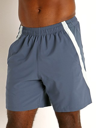 "Model in mechanic blue/reflective Under Armour Launch 7"" Running Short"