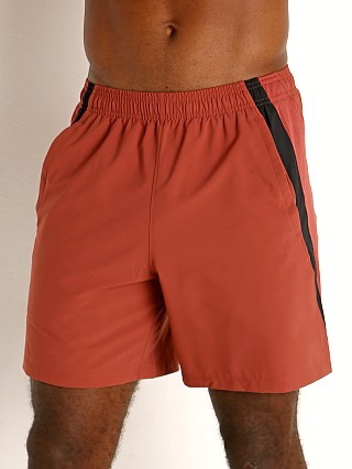 "Model in cinna red/reflective Under Armour Launch 7"" Running Short"