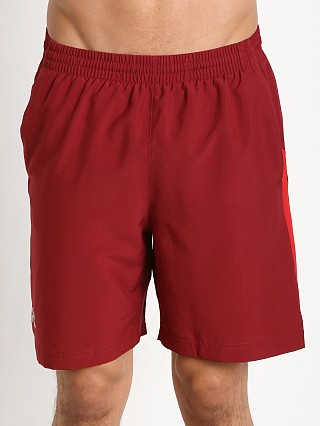"Model in cardinal/red Under Armour Launch 7"" Solid Short"