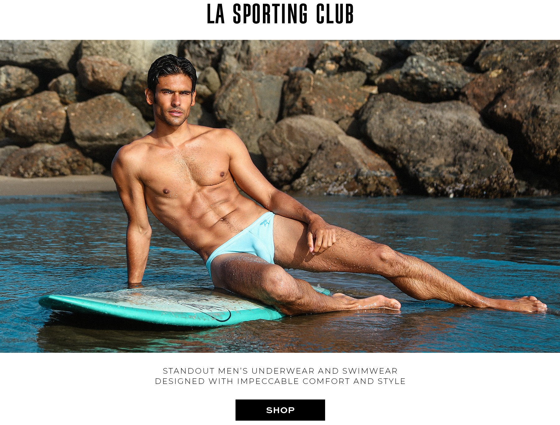 LASC swimwear worn at the beach by surfer